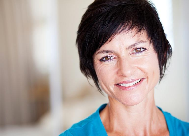 smiling older woman with dark hair